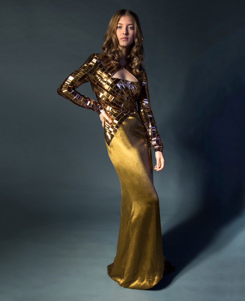 Woman in gold dress fashion photography